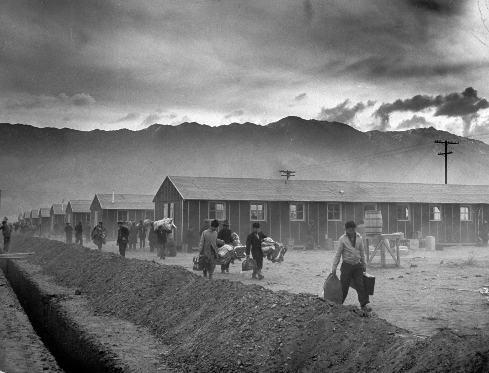 Japanese Americans walking into internment camp